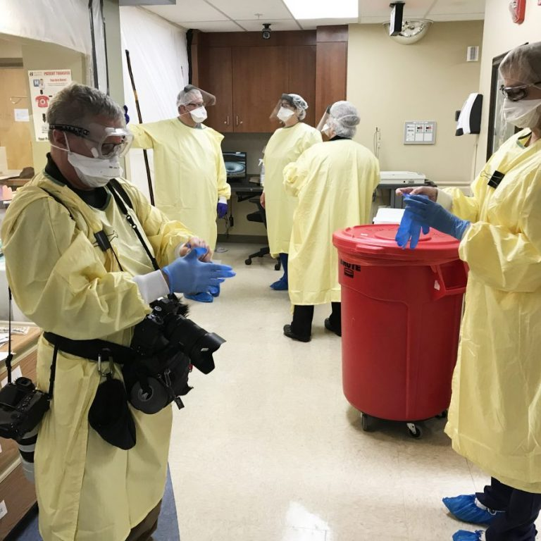 Staff members at Scotland County Hospital put on personal protective equipment to care for patients in isolation. The hospital is struggling with having enough staff available to provide care for patients.