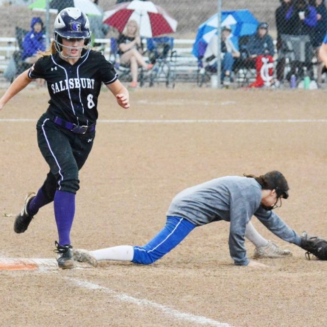 First baseman Kwyn Hamlin makes a super stretch to get the out on Kate Kottman.