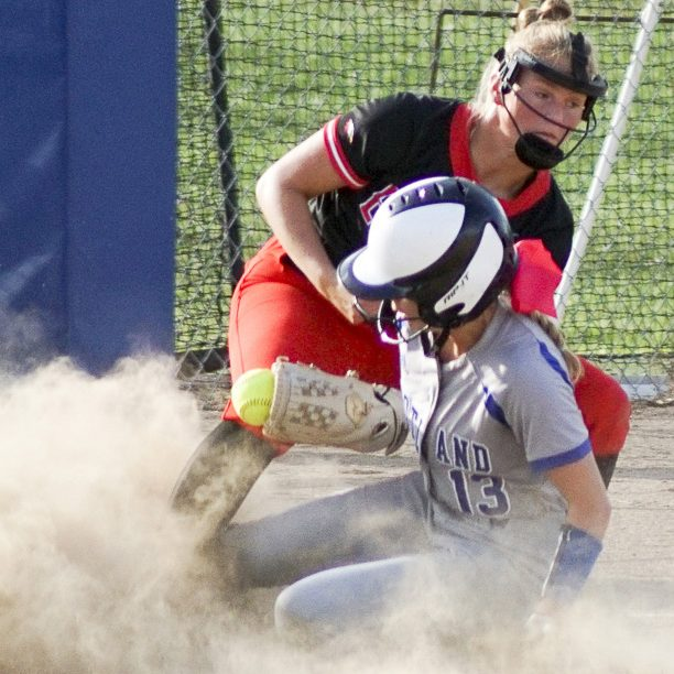 LADY TIGERS SLIDE IN FOR WIN-Scotland County base runner Hannah Feeney (shown on the right) slides in to third base during a 19-11 Lady Tiger win over Knox County. Jen Hinkle takes the throw for the Lady Eagles. Feeney and Hinkle had four hits each on the day. Photo by David Sharp.