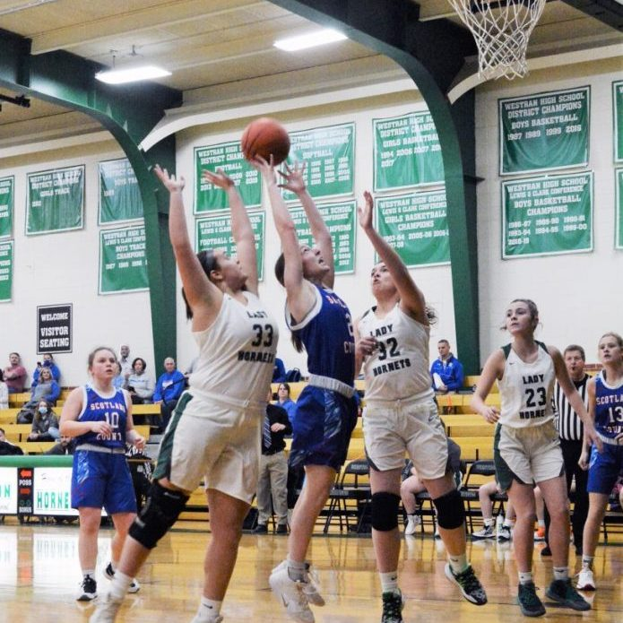 Senior guard Morgan Blessing drives to the hoop for the score against Westran's Maddy Harvey (33) and Kenzie Black (23).
