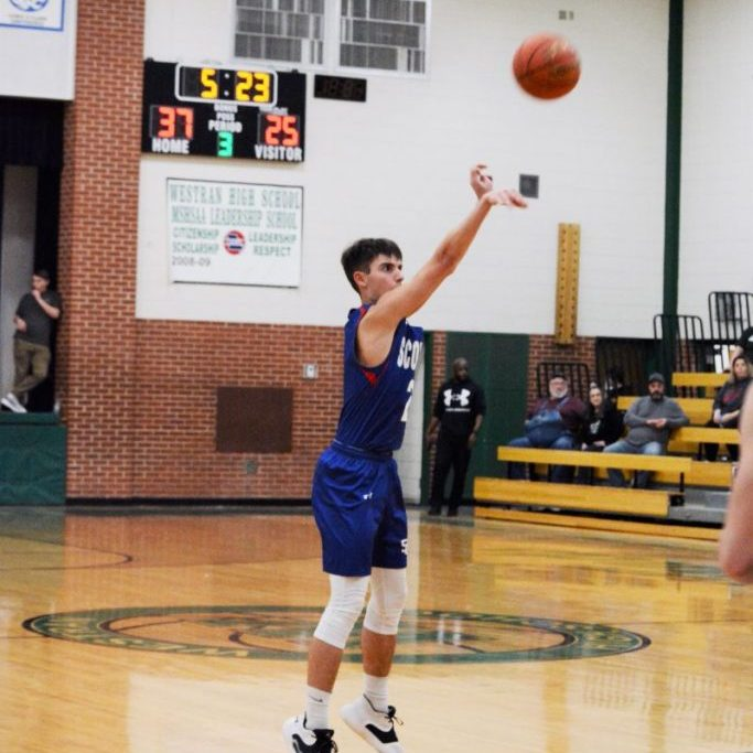 Jared Cerroni launches a three-pointer from the top of the key in third quarter action at Westran.