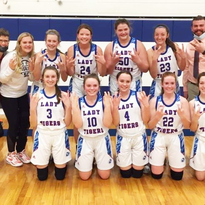 The Scotland County Lady Tigers won the Lewis and Clark Conference title outright with a 54-29 victory over Salisbury to go undefeated in conference play. Front row (l-r): Kylee Stott, Aayla Humphrey, Paige Bishop, Kilee Bradley-Robinson and Morgan Blessing. Back row (l-r): assistant coach Karri Feeney, Abby Curry, Hannah Feeney, Abby Doster, Alaynna Whitaker, Emiley Dial and head coach Cory Shultz.