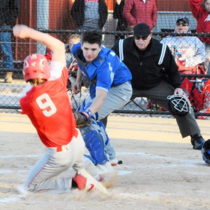 Scotland County catcher Ian Wilson tags out Drew Holsted as he tries to steal home in the bottom of the seventh inning.
