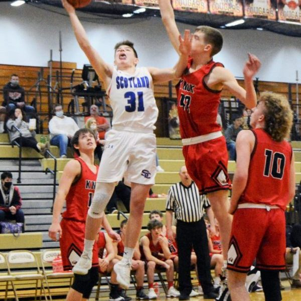 "Sophomore guard Owen Triplett attacks the rim against Knox County 6'6"" forward Nelson Shinkle in the consolation semi-final at the Highland Tournament."