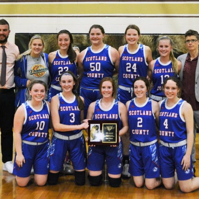 The Scotland County Lady Tigers took home the 2nd place hardware from the Highland Tournament after a 49-33 loss Saturday night. Front row (l-r): Aayla Humphrey, Kylee Stott, Kilee Bradley-Robinson, Morgan Blessing and Paige Bishop. Back row (l-r): Head Coach Cory Shultz, Abby Curry, Emiley Dial, Alaynna Whitaker, Abby Doster, Hannah Feeney and Assistant Coach Karri Feeney.